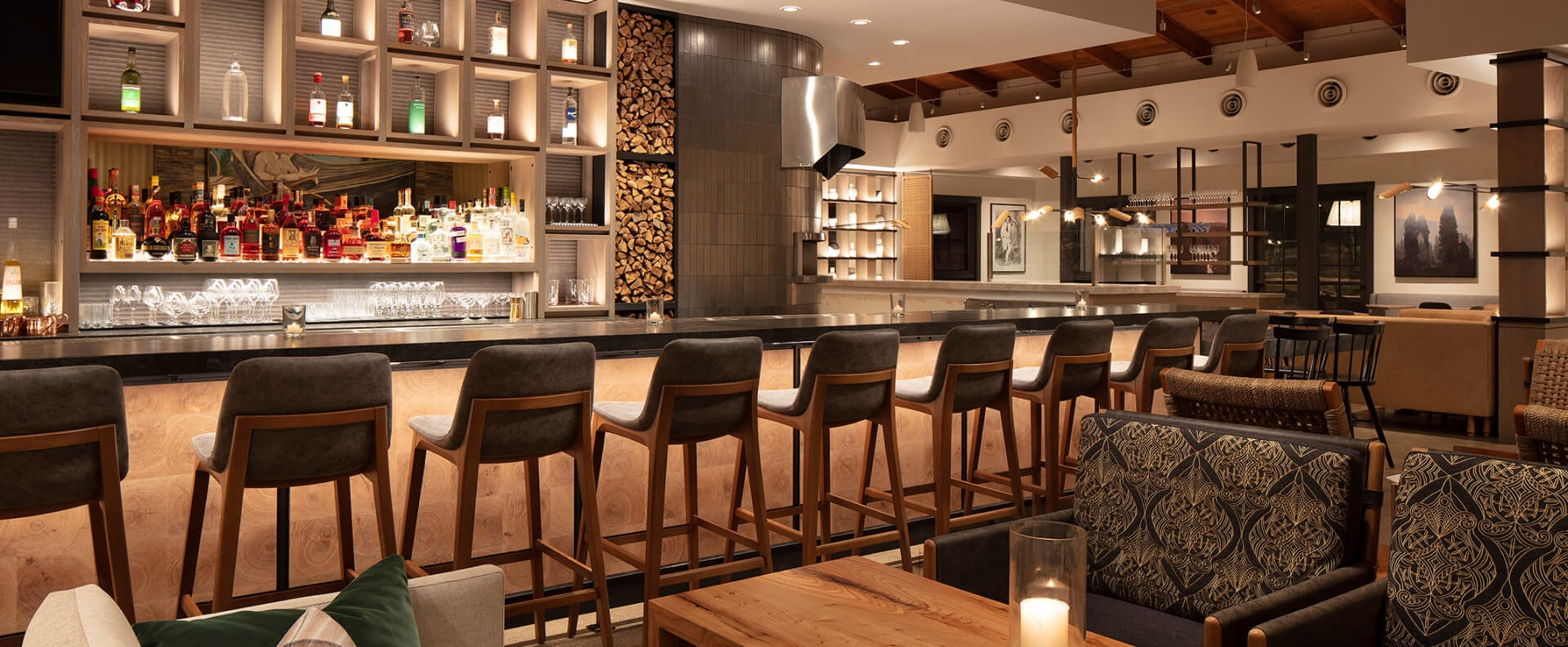 A row of chairs line the bar at The Lodge at Sonoma, Wit & Wisdom.